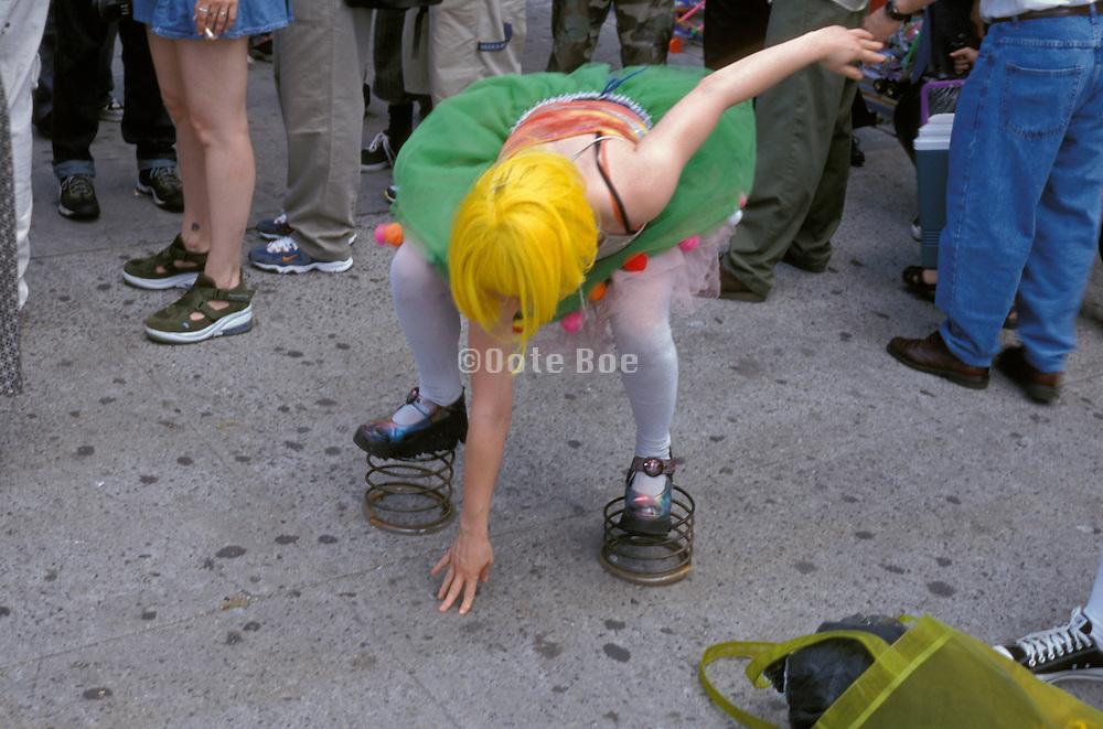 girl walking on springs in a crowd