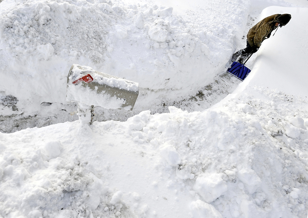 A man shovels a walkway to a mailbox in Manchester, Conn., after a winter snow storm. (AP Photo/Jessica Hill)