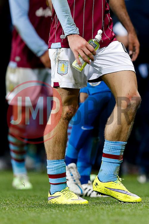 The trademark low socks of Jack Grealish of Aston Villa (making his first Premier League start) - Photo mandatory by-line: Rogan Thomson/JMP - 07966 386802 - 07/04/2015 - SPORT - FOOTBALL - Birmingham, England - Villa Park - Aston Villa v Queens Park Rangers - Barclays Premier League.