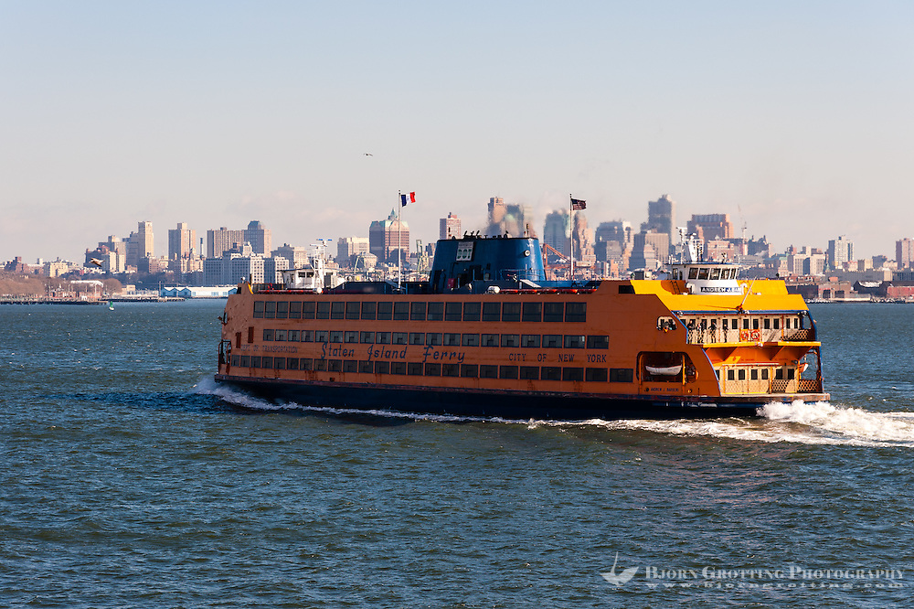 US, New York City. The Staten Island Ferry with Lower Manhattan in the background.