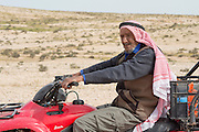 Israel, Negev Desert, Bedouin shepherd on an all terrain vehicle