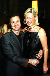 Fashion designer JACQUES AZAGURY and MISS NICKY CLARK, at an award ceremony in London on 9th December 1999.MZX 63