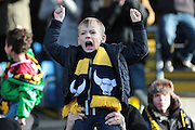 Oxford United fans celebrate their win in The FA Cup third round match between Oxford United and Swansea City at the Kassam Stadium, Oxford, England on 10 January 2016. Photo by Jemma Phillips.