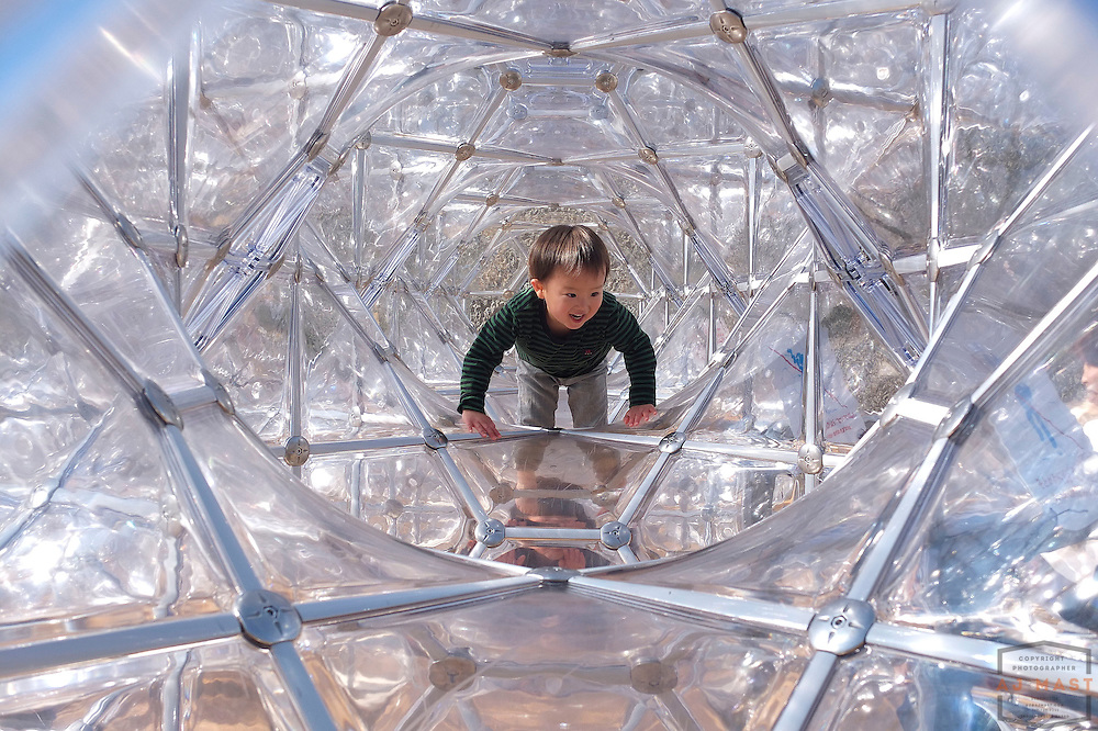 Children play in the Curved space diamond structure at  the Hakone Open-Air Museum, Japan Friday, Nov. 23, 2011.