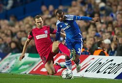 LONDON, ENGLAND - Wednesday, October 19, 2011: Chelsea's Ashley Cole in action against Racing Genk's Thomas Buffel during the UEFA Champions League Group E match at Stamford Bridge. (Photo by Chris Brunskill/Propaganda)