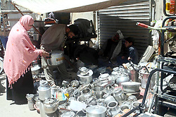 April 29, 2019 - Quetta, Pakistan - A man sells utensils to earn his livelihood for support his family at his shop located in Qandhari Bazar in Quetta. (Credit Image: © PPI via ZUMA Wire)