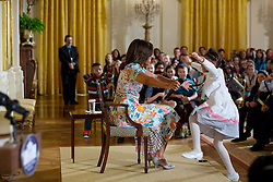 """First Lady Michelle Obama reaches out to hug a child attending the annual """"Take Our Daughters and Sons to Work Day"""" event in the East Room of the White House, April 22, 2015. (Official White House Photo by Lawrence Jackson)<br /> <br /> This official White House photograph is being made available only for publication by news organizations and/or for personal use printing by the subject(s) of the photograph. The photograph may not be manipulated in any way and may not be used in commercial or political materials, advertisements, emails, products, promotions that in any way suggests approval or endorsement of the President, the First Family, or the White House."""
