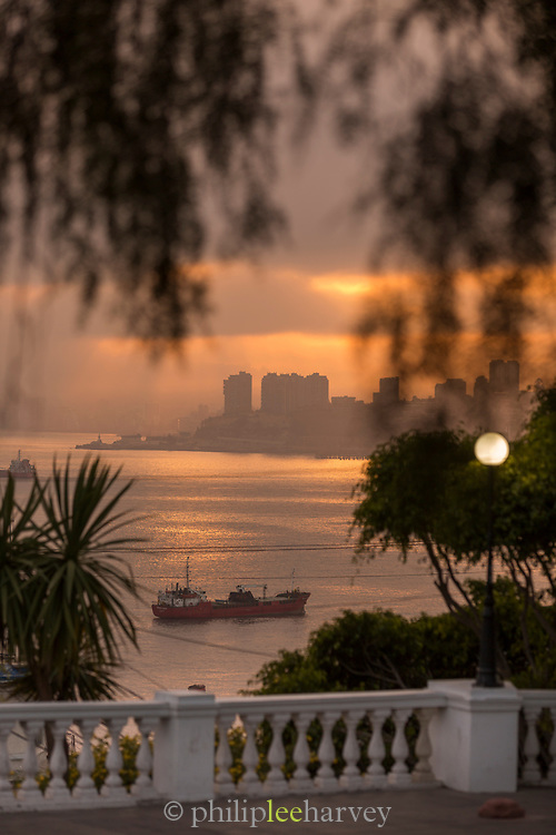 Dawn over skyline and sea with ship from balcony Valparaiso, Chile