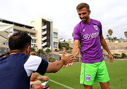Gary O'Neil shakes hands with coach Scott Murray before entering as a sub - Mandatory by-line: Matt McNulty/JMP - 22/07/2017 - FOOTBALL - Tenerife Top Training - Costa Adeje, Tenerife - Bristol City v Atletico Union Guimar  - Pre-Season Friendly