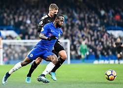 January 13, 2018 - London, England, United Kingdom - Chelsea's Victor Moses battles for possession with Leicester City's Marc Albrighton..during the Premier League match between Chelsea and Leicester City at Stamford Bridge, London, England on 13 Jan t 2018. (Credit Image: © Kieran Galvin/NurPhoto via ZUMA Press)