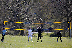 © Licensed to London News Pictures. 17/04/2021. London, UK. Members of the public play volleyball in a sunny Hyde Park in Central London. Temperatures are expected to rise with highs of 16 degrees forecasted for parts of London and South East England later this week . Photo credit: George Cracknell Wright/LNP