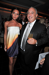 VICTORIA BECKHAM and SIR PHILIP GREEN at a dinner hosted by Alexandra Shulman editor of British Vogue in association with Net-A-Porter.com to celebrate 25 years of London Fashion Week and Nick Knight held at Le Caprice, Arlington Street, London on 21st September 2009.