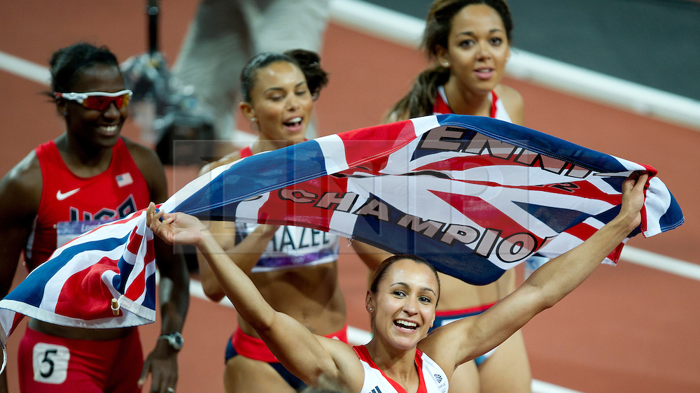 © Licensed to London News Pictures. 06/06/2012. London,Britain.Jessica Ennis celebrates at the end of the 800m race, winning the gold medal in the Women's Heptathlon, at the Olympic Stadium, in London, during the London 2012 Olympic Games.  Photo credit : Bogdan Maran/LNP/BPA