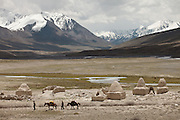 A caravan at the shrines of Bozoi Gumbaz. at the entrance to the Little Pamir Plateau, beside the Waghjir river, one of the claimed source of the Oxus river...Trekking up and along the Wakhan river, the only way to reach the high altitude Little Pamir plateau, home of the Afghan Kyrgyz community.