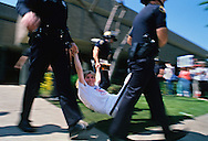 An abortion rights protester is arrested and removed during a rally in Los Angeles.