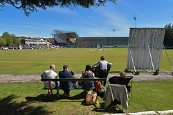 Fans watch a cricket match at Burnley Cricket Club next to Turf Moor prior to the Premier League match at Turf Moor, Burnley.