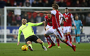 Brighton central midfielder, Beram Kayal (7) slide tackles during the Sky Bet Championship match between Rotherham United and Brighton and Hove Albion at the New York Stadium, Rotherham, England on 12 January 2016.