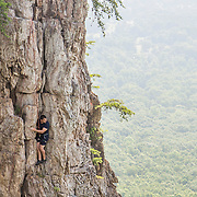A climber pauses to take a view during his climb at Crowders Mountain.