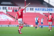 Cauley Woodrow of Barnsley (9) scores a goal and celebrates to the crowd to make the score 2-0 during the EFL Sky Bet League 1 match between Barnsley and Wycombe Wanderers at Oakwell, Barnsley, England on 16 February 2019.