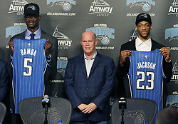 June 22, 2018 - Orlando, FL, USA - Orlando Magic head coach Steve Clifford stands between draft picks Mo Bamba (5) and Justin Jackson (23) during a news conference at the Amway Center in Orlando, Fla., on Friday, June 22, 2018. (Credit Image: © Stephen M. Dowell/TNS via ZUMA Wire)