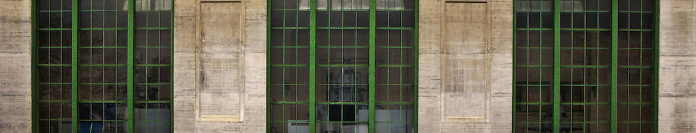 Windows looking in to the turbine generators of the Cushman Tacoma Power Station along the Hood Canal of Puget Sound, Washington state, USA panorama