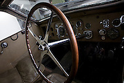 Found in a garage where it had been stored virtually untouched for 50 years, this 1937 Bugatti Type 57s Atalante sports car is previewed for the first time before a Bonhams auction in Paris on February 7th 2009. Here, we see a detail of the steering wheel and dashboard while in a garage/studio before the auction and sale in Paris. In 2008 the Bugatti Type 57S with chassis number 57502 built in 1937 with the Atalante coachwork for Earl Howe was discovered in a private garage in Newcastle upon Tyne, having been stored untouched for 48 years and known about only by a select few people. It was auctioned in February 2009 at the Retromobile motor show in Paris, France, fetching EUR3.4 million (US$4.6 million), becoming one of the highest valued cars in automotive history, owing much to its extremely low mileage, original condition and ownership pedigree.
