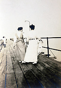 two adult women walking on a boat landing