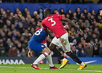 Football - 2019 / 2020 Premier League - Chelsea vs. Manchester United<br /> <br /> Eric Bailly (Manchester United) throws aside the block of Cesar Azpilicueta (Chelsea FC) as the corner swings in at Stamford Bridge <br /> <br /> COLORSPORT/DANIEL BEARHAM