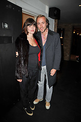 SAM PELLY and his wife SUSI at a screening of the short film 'The Volunteer' held at the Courthouse Hilton Hotel, 19-21 Great Marlborough Street, London W1 on 26th October 2009.