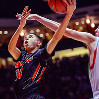 031415  Adron Gardner/Independent<br /> <br /> Gallup Bengal Damian Romero (10) attempts a shot ahead of Centennial Hawk James Mulheron (42) during a 5A New Mexico state basketball tournament final at The Pit in Albuquerque Saturday.