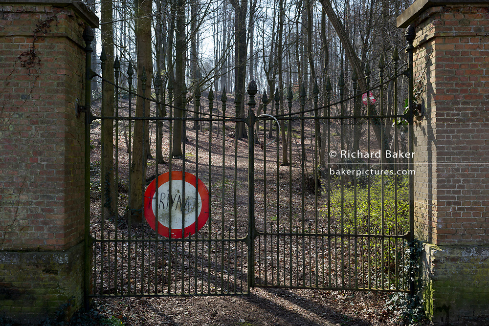 Makeshift sign in Flemish warning of private property at the gates of an old estate, on 25th March, in Everberg, Brabant, Belgium.
