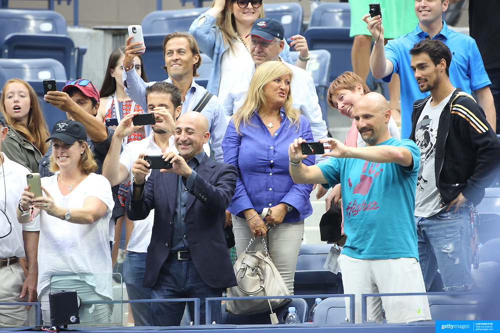 The team of Flavia Pennetta, Italy, celebrates victory against Roberta Vinci Italy, in the Women's Singles Final match during the US Open Tennis Tournament, Flushing, New York, USA. 12th September 2015. Photo Tim Clayton