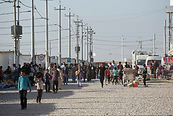 Licensed to London News Pictures. 22/10/2016. A crowded main street is seen in the Dibaga refugee camp near Makhmur, Iraq.<br />