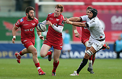 Scarlets' Rhys Patchell gets away from RC Toulon's Juandre Kruger during the European Champions Cup, pool three mach at Parc y Scarlets, Llanelli.