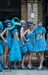© licensed to London News Pictures. Bermondsey, London, UK  08/06/2011. 19 models wearing turquoise dresses by fashion designer Pierre Garroudi setting out on a flashmob in Bermondsey, London. Models outside Pierre Garroudi's studio in Bermondsey. Please see special instructions for usage rates. Photo credit should read Bettina Strenske/LNP