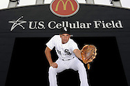 CHICAGO - JULY 28:  Omar Vizquel #11 of the Chicago White Sox poses for a portrait at various locations within U.S. Cellular Field while honoring fellow Venezuelan shortstop and baseball Hall-of-Famer Luis Aparicio prior to the game against the Seattle Mariners on July 28, 2010 at U.S. Cellular Field in Chicago, Illinois.   (Photo by Ron Vesely)