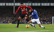 Anthony Martial of Manchester United and Mason Holgate of Everton during the Premier League match at Goodison Park, Liverpool. Picture date: December 4th, 2016.Photo credit should read: Lynne Cameron/Sportimage