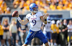Oct 6, 2018; Morgantown, WV, USA; Kansas Jayhawks quarterback Carter Stanley (9) throws a pass during the first quarter against the West Virginia Mountaineers at Mountaineer Field at Milan Puskar Stadium. Mandatory Credit: Ben Queen-USA TODAY Sports