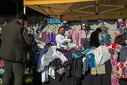 "A ""Joy Market"" in Jamestown, Stellenbosch, on June 16, 2020. Here people stood in social-distancing lines to pick out free, donated clothing. The market was<br /> organized by a joint Jamestown community taskforce formed in response to families in need during lockdown due to COVID-19. June 16 is Youth Day in South Africa, a public holiday that commemorates the Soweto uprising of 1976. ""We responded to the call during lockdown. Our first priority was the kids,"" said Arnold Okkers, executive director of Usiko, a Jamestown youth organization. When lockdown started, Usiko began by providing lunch for the 120 kids the organization normally looks after in after-school programs. ""Within a week, it doubled to 250,"" adds Okkers. The feeding scheme quickly grew to a joint community volunteer effort. The Jamestown volunteer taskforce and supporters have been feeding about 400 people per day here, as many people lost their jobs during lockdown. Okkers says they will be able to scale back the feeding scheme a little bit now, as people have been able to return to work during Level 3 of lockdown. ""More and more people are able to care for themselves,"" he says. PHOTO: EVA-LOTTA JANSSON"