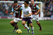 Everton's Steven Pienaar gets past Burnley's George Boyd. Barclays Premier league match, Burnley v Everton at Turf Moor in Burnley, Lancs on Sunday 26th October 2014.<br /> pic by Chris Stading, Andrew Orchard sports photography.