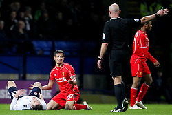 Liverpool's Phillipe Coutinho reacts after fouling Dorian Dervite of Bolton Wanderers - Photo mandatory by-line: Matt McNulty/JMP - Mobile: 07966 386802 - 04/02/2015 - SPORT - Football - Bolton - Macron Stadium - Bolton Wanderers v Liverpool - FA Cup - Fourth Round