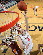 Dec. 30, 2010; Charlottesville, VA, USA; Virginia Cavaliers forward Will Regan (4) shots the ball in front of Iowa State Cyclones guard Darion 'Jake' Anderson (5) during the game at the John Paul Jones Arena. Iowa State Cyclones won 60-47. Mandatory Credit: Andrew Shurtleff