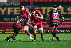 Scarlets' Lewis Rawlins is tackled by Dragons' Liam Belcher<br /> <br /> Photographer Craig Thomas/Replay Images<br /> <br /> Guinness PRO14 Round 13 - Scarlets v Dragons - Friday 5th January 2018 - Parc Y Scarlets - Llanelli<br /> <br /> World Copyright © Replay Images . All rights reserved. info@replayimages.co.uk - http://replayimages.co.uk