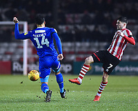 Lincoln City's Tom Pett vies for possession with Morecambe's Josef Yarney<br /> <br /> Photographer Andrew Vaughan/CameraSport<br /> <br /> The EFL Sky Bet League Two - Saturday 15th December 2018 - Lincoln City v Morecambe - Sincil Bank - Lincoln<br /> <br /> World Copyright © 2018 CameraSport. All rights reserved. 43 Linden Ave. Countesthorpe. Leicester. England. LE8 5PG - Tel: +44 (0) 116 277 4147 - admin@camerasport.com - www.camerasport.com