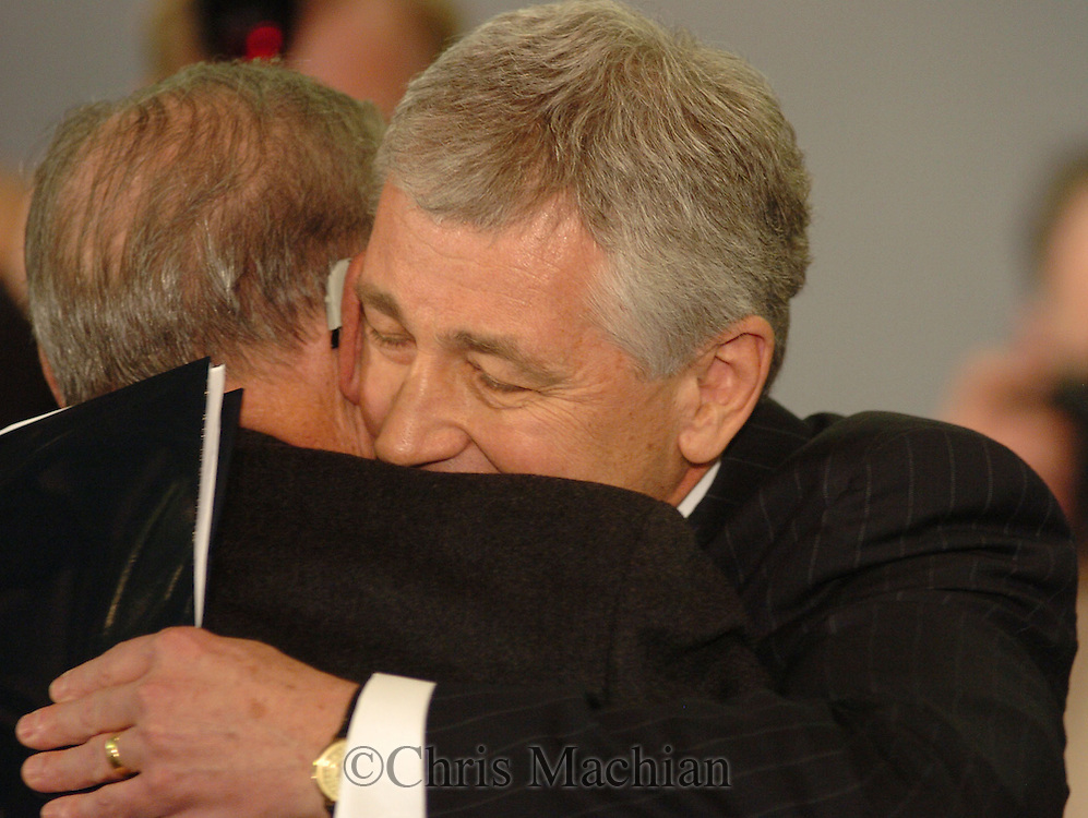3/12/07 Omaha NE Nebraska Senator Chuck Hagel hugs former  Congressman John Y. McCollister, with he was an assstant with in the 1970s.  This was after Hagel made the announcement that he is waiting to decide about running for President at the University of Nebraska  at Omaha. (photo by Chris Machian/ Prairie Pixel Group)