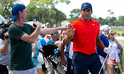 February 28, 2019 - Palm Beach Gardens, Florida, U.S. - Jhonattan Vegas high fives a fan after hitting his approach shot on the 9th hole during the first round of the Honda Classic Thursday at PGA National Resort and Spa in Palm Beach Gardens, February 28, 2019. Vegas made par on the hole and finished the first round 6 under par. (Credit Image: © Allen Eyestone/The Palm Beach Post via ZUMA Wire)