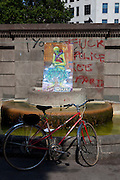 "Bicycle and ""fuck police"" graffiti at protest camp at Placa de Catalunya, Barcelona, Spain. The square has been relatively quiet since police attacked and beat protestors on May 27 2011."