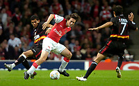 Photo: Ed Godden/Sportsbeat Images.<br /> Arsenal v Sevilla. UEFA Champions League Group H. 19/09/2007. Arsenal's Tomas Rosicky (c), tussles with Daniel Alves.