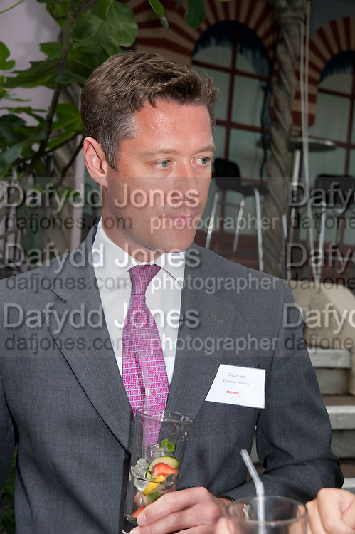 GILES COOK; CHESTERTON HUMBERTS, Archant Summer party. Kensington Roof Gardens. London. 7 July 2010. -DO NOT ARCHIVE-© Copyright Photograph by Dafydd Jones. 248 Clapham Rd. London SW9 0PZ. Tel 0207 820 0771. www.dafjones.com.