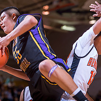 121913       Cable Hoover<br /> <br /> Kirtland Central Bronco Seldon Watson (35) knocks away Gallup Bengal Cody Tabaha (13) as he grabs a rebound Thursday at Gallup High School.